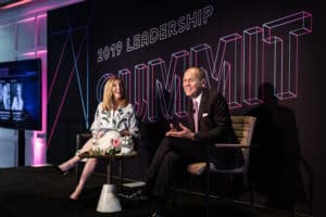 Eva Hughes and Robert Chavez in fireside chat with a luxury CEO, The Alumni Society Leadership Summit 2019